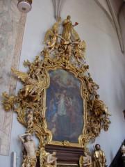 Boční oltář s obrazem sv. Augustina a sochou sv. Moniky